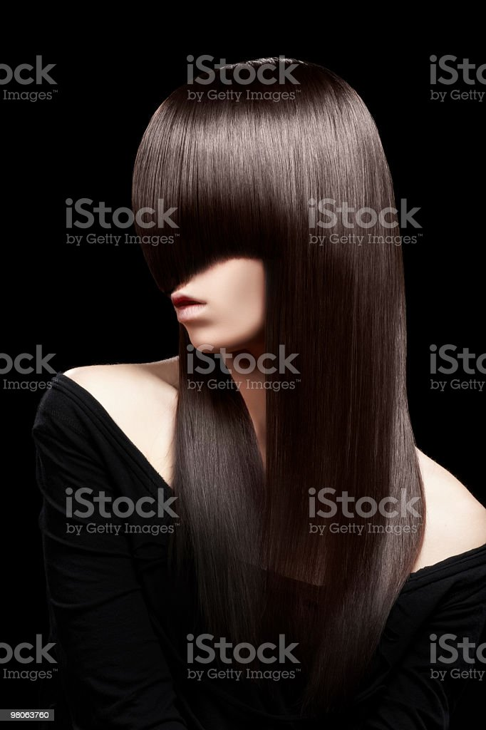 Fashion portrait of young beautiful woman on black background royalty-free stock photo
