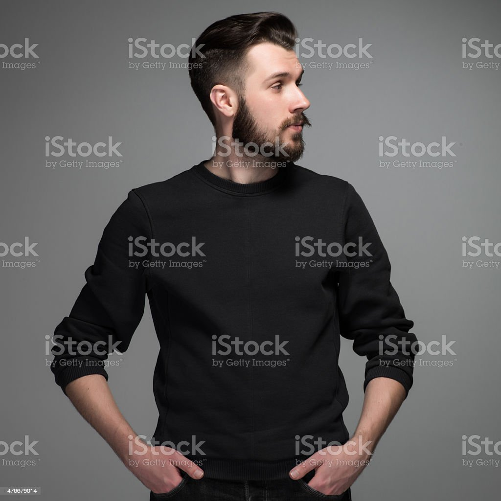 Fashion portrait of young man in black stock photo
