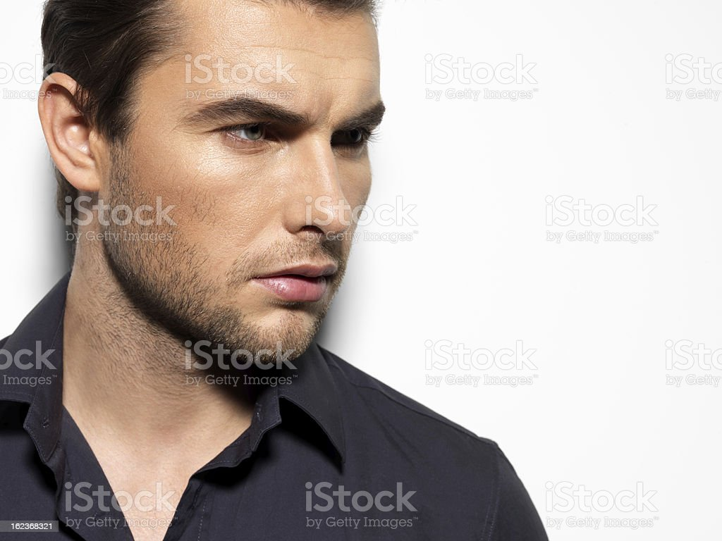 Fashion portrait of young man in black shirt royalty-free stock photo