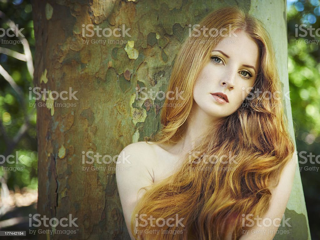 Fashion portrait of young naked woman in garden royalty-free stock photo
