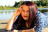 Fashion portrait of young sensual woman near river