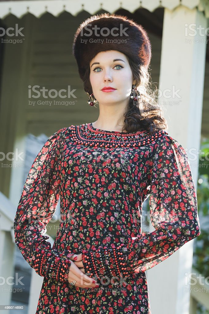 Fashion portrait of young woman in Russian medieval style clothing stock photo