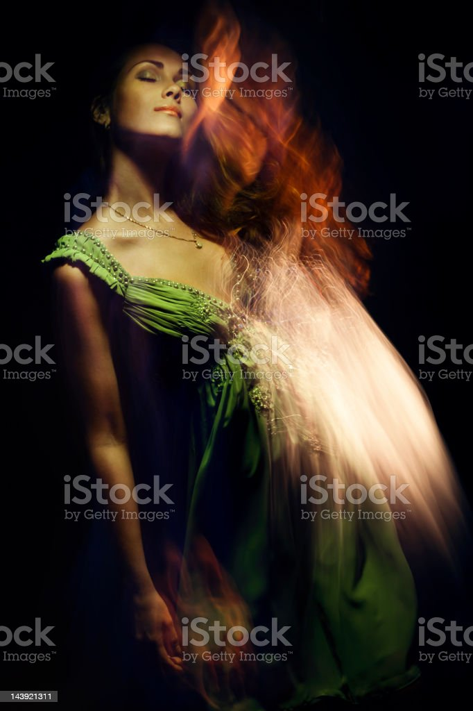 Fashion portrait of young woman on black background. stock photo