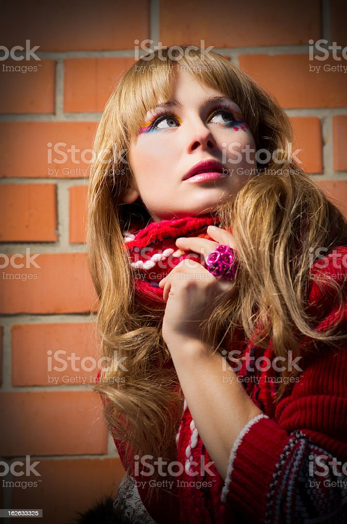 Fashion portrait of young woman on brick wall royalty-free stock photo