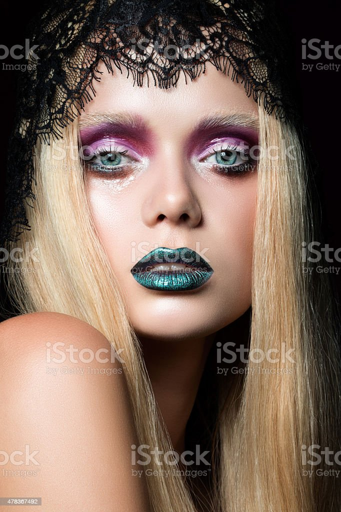 Fashion portrait of young woman with blue lips stock photo