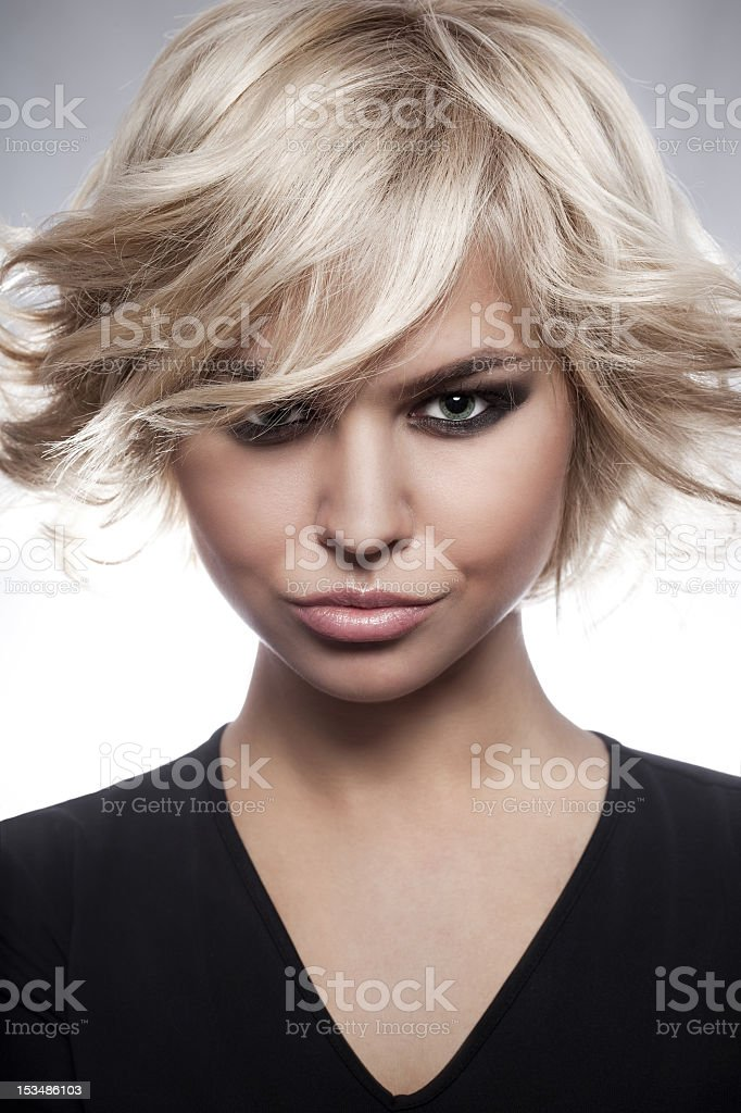Fashion portrait on of sexy woman in short blonde hair royalty-free stock photo