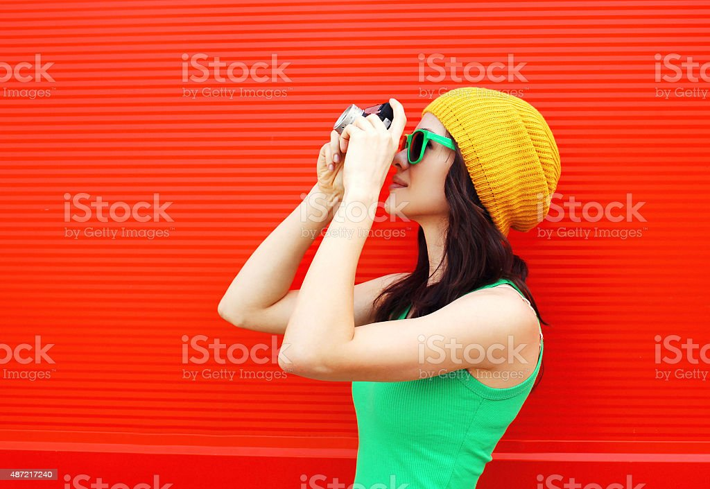 Fashion pretty cool girl wearing a colorful clothes with camera stock photo