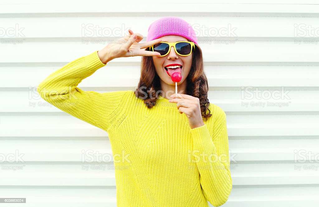 fashion pretty cool girl with lollipop in colorful clothes stock photo