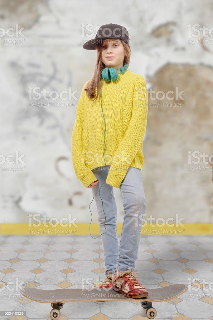 fashion pretty little girl with skateboard stock photo