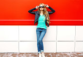Fashion pretty woman model in sunglasses black rock jacket posing