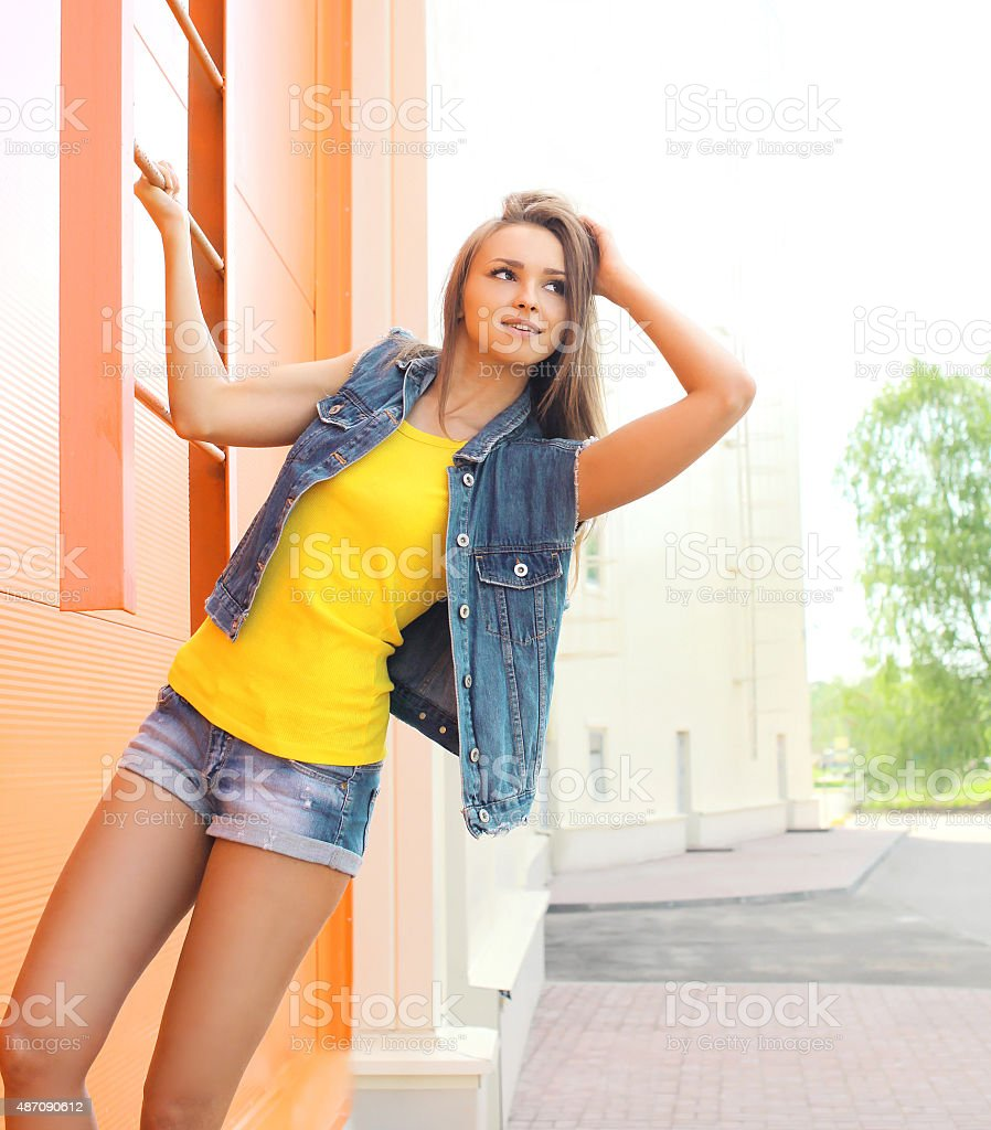 Fashion pretty woman wearing a jeans clothes outdoors stock photo