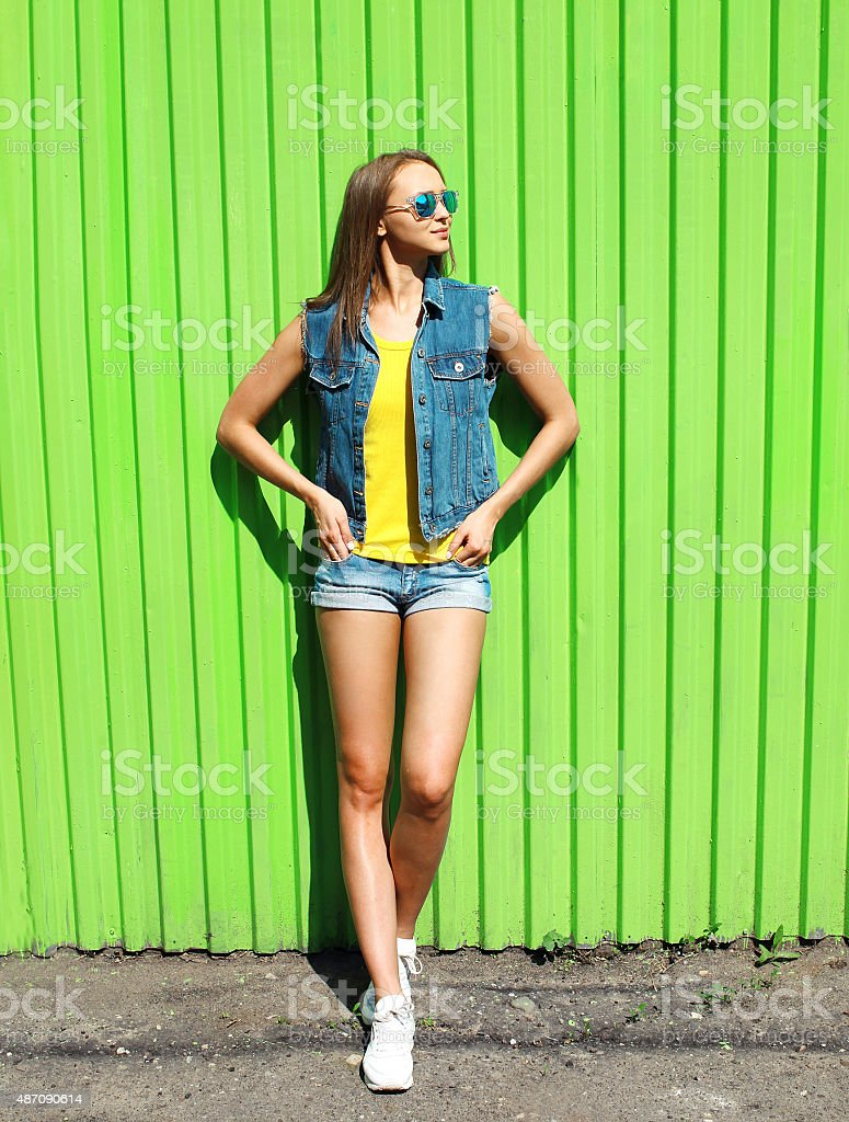 Fashion pretty woman wearing a sunglasses and jeans clothes over stock photo