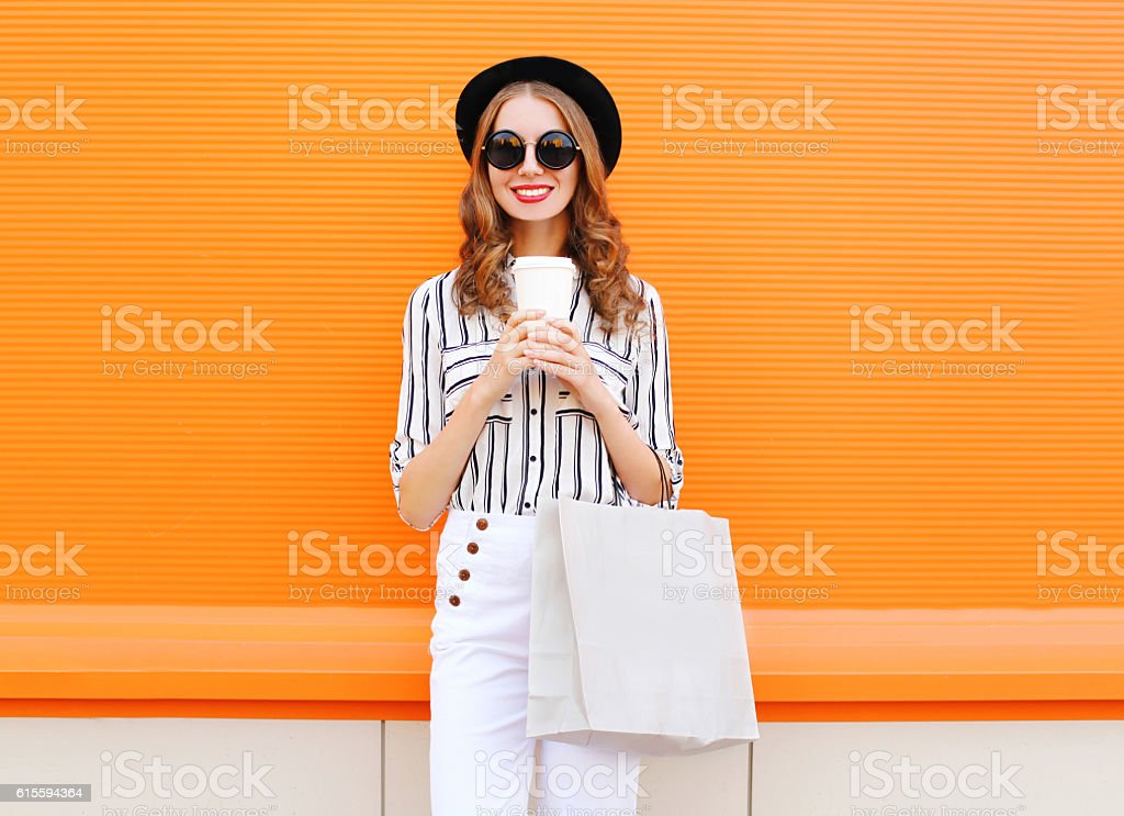 Fashion pretty young smiling woman model, shopping bag, coffee cup stock photo
