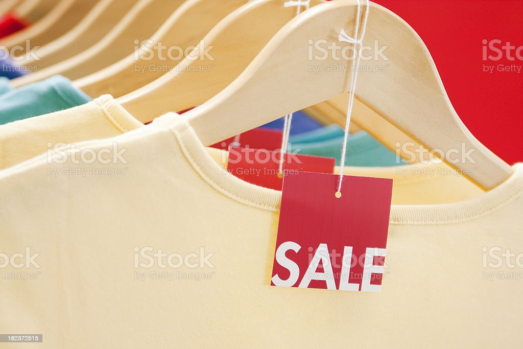 Fashion Sale- Shopping in a Retail Clothing Store royalty-free stock photo