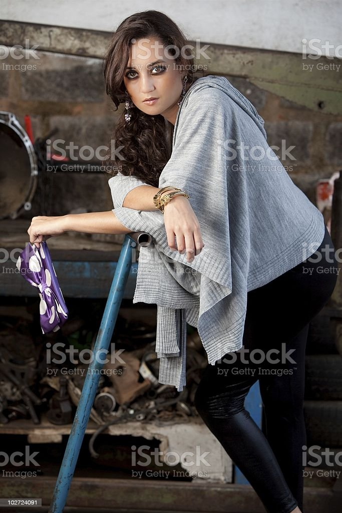 Fashion shot in auto repair shop. royalty-free stock photo