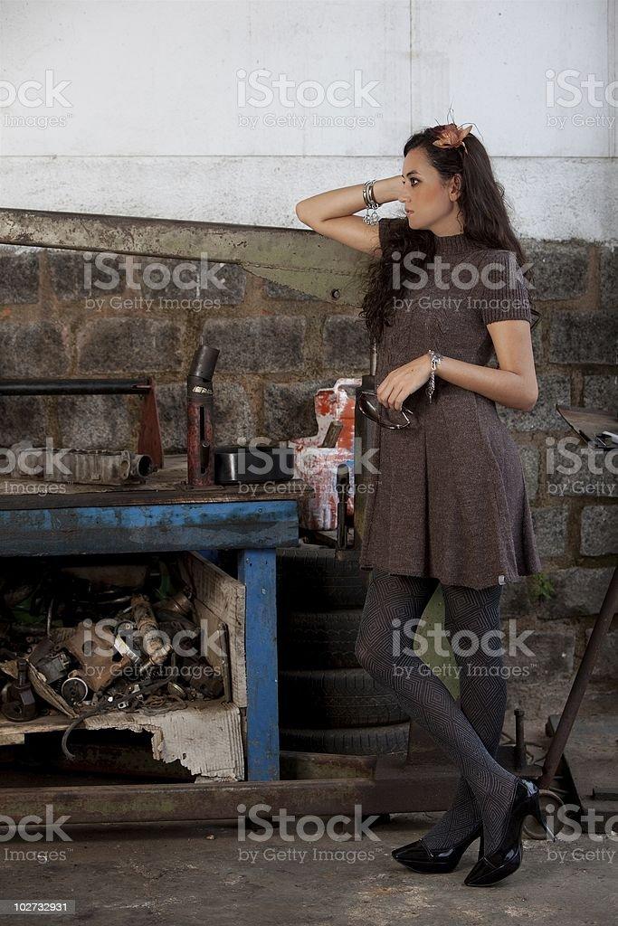 Fashion shot in auto repair shop. royalty-free stock photo