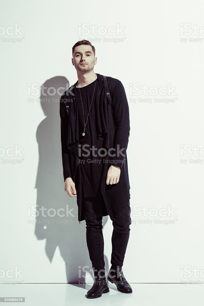 Fashion shot of a handsome man wearing elegant suit and stock photo
