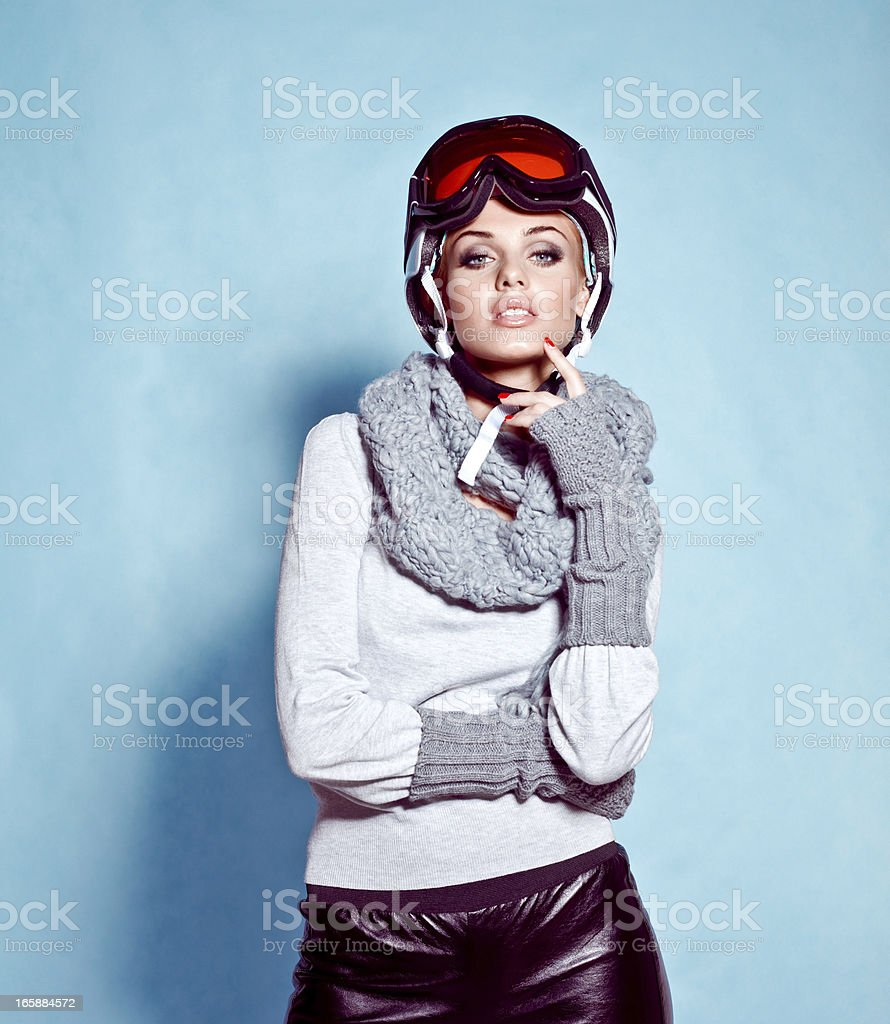 Fashion shot of young woman in winter ski gear royalty-free stock photo