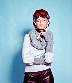 Fashion shot of young woman in winter ski gear