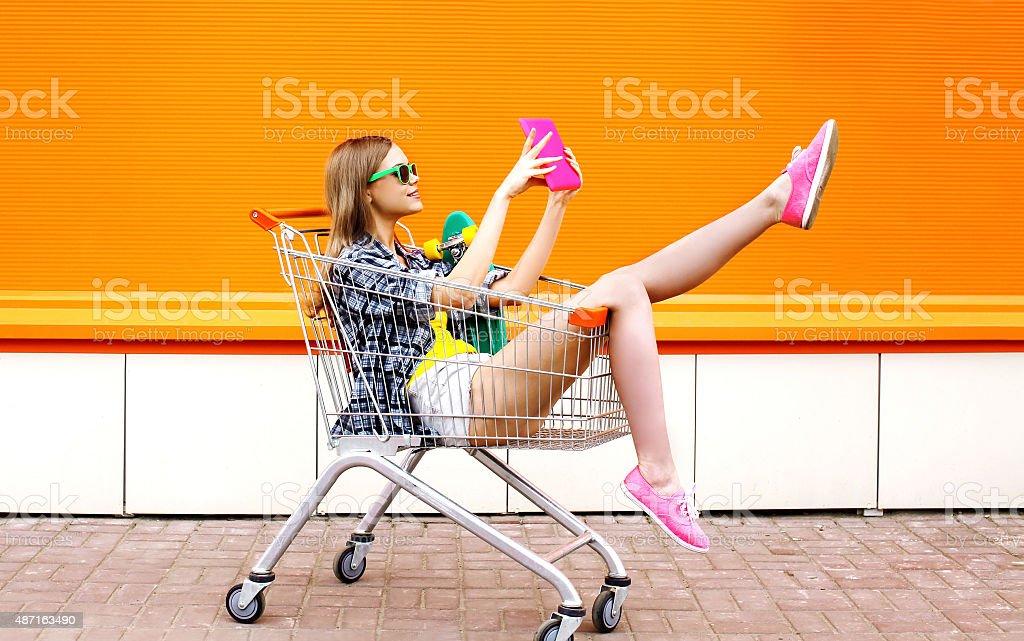 Fashion smiling hipster woman having fun taking picture self-por stock photo