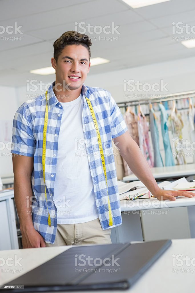 Fashion student posing with meter around his neck stock photo