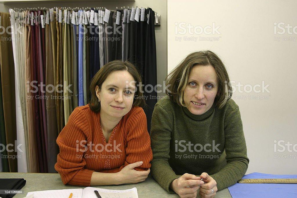 Fashion studio. Shop-assistants royalty-free stock photo