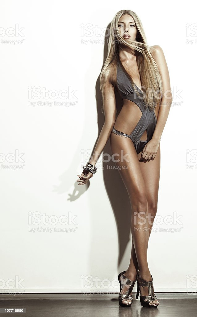 Fashion studio shot of young beautiful woman royalty-free stock photo