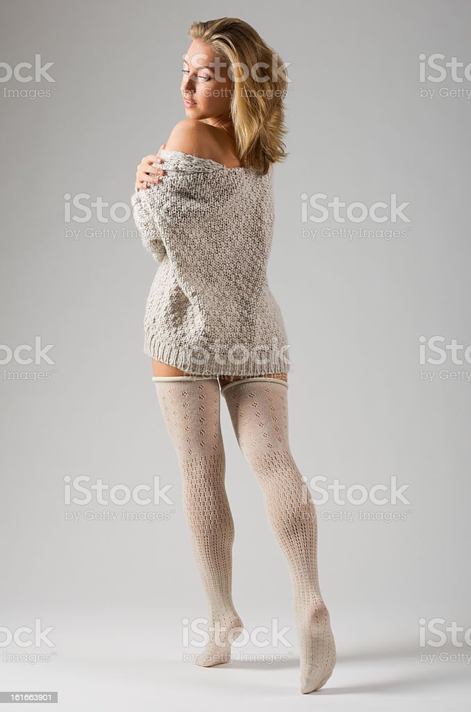 Fashion stye portrait of young girl on grey royalty-free stock photo
