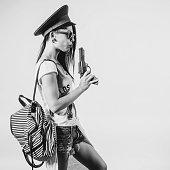 Fashion swag sexy girl blowing on smoke toy gun woman