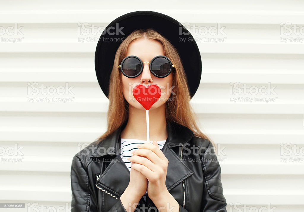 Fashion sweet woman having fun with lollipop over white background stock photo