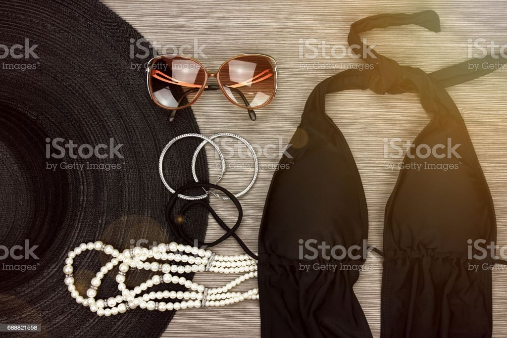 Fashion swimsuit and vintage accessories, Summer clothes, swimwear, sunglasses, earrings, necklace and wide brim sun hat, Stylish luxury accessories. stock photo