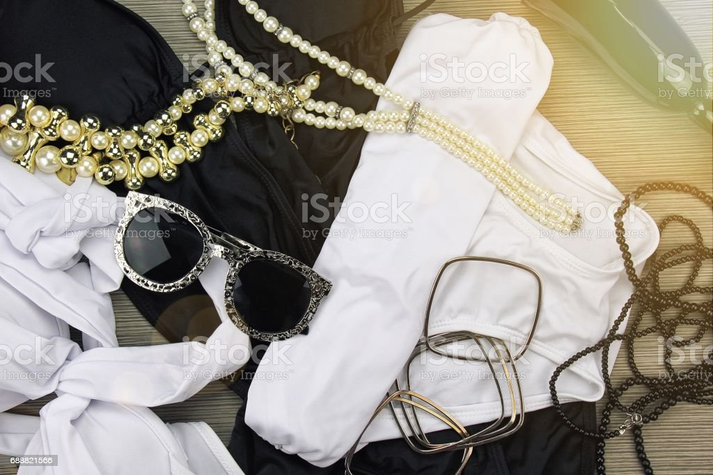 Fashion swimsuit bikini and vintage accessories, Summer clothes, swimwear, sunglasses and necklace. Stylish luxury accessories. stock photo