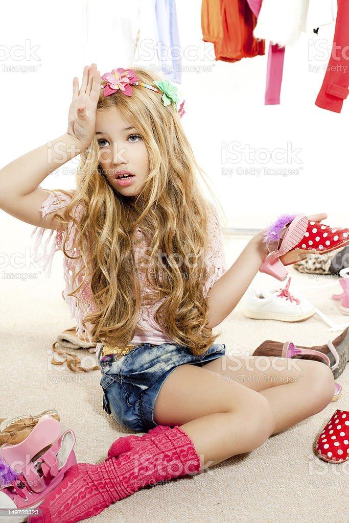 fashion victim kid girl wardrobe messy backstage royalty-free stock photo