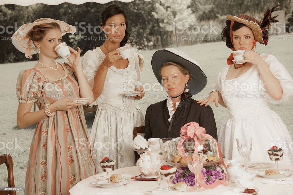 Fashion: Victorian style women have afternoon tea. stock photo