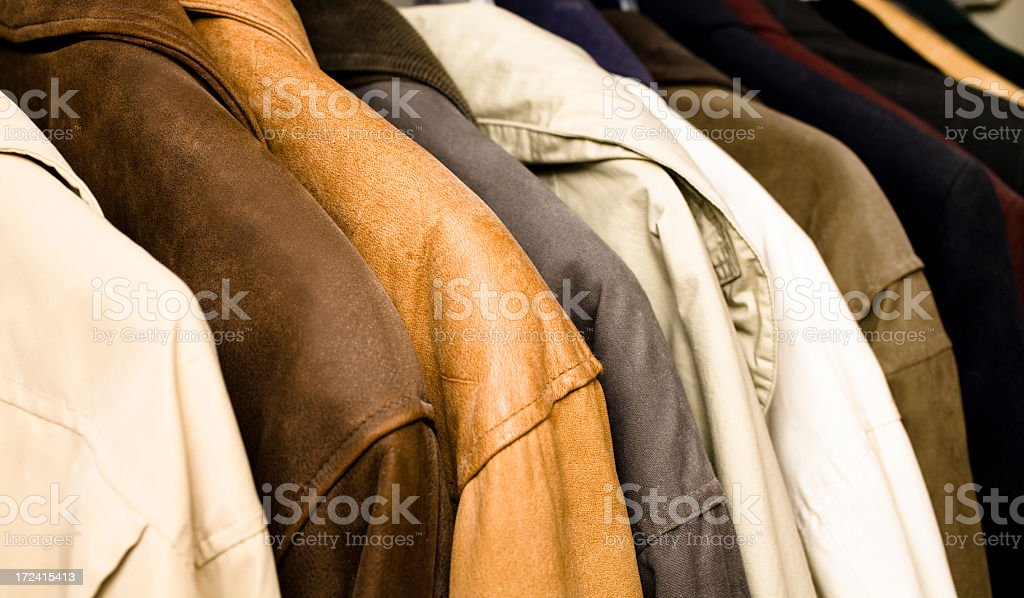Fashion:  Winter coats and jackets in a row, hanging closet. royalty-free stock photo