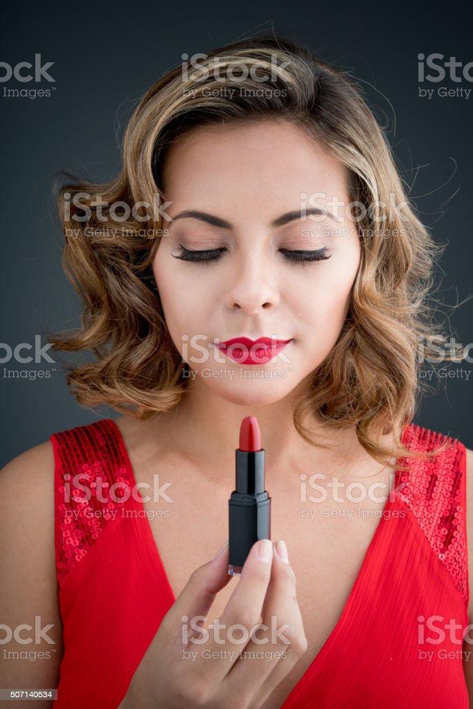 Fashion woman applying red lipstick stock photo