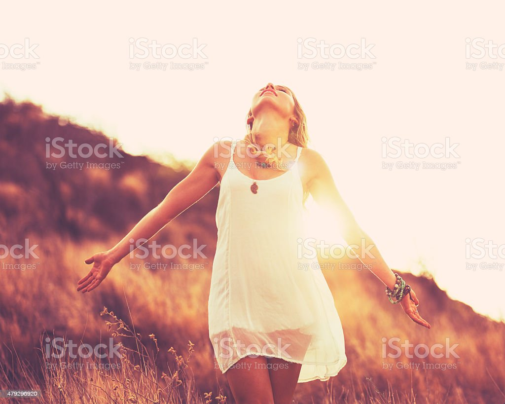 Fashion Woman at Sunset stock photo