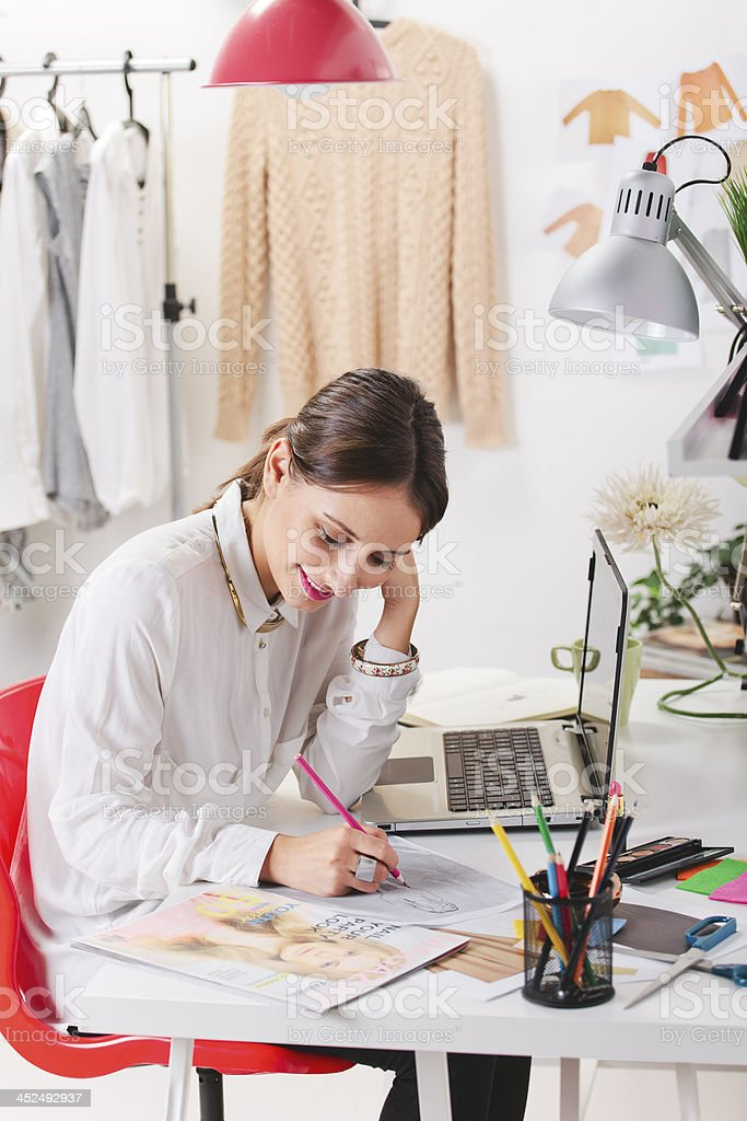 Fashion woman blogger working in a creative workspace. stock photo