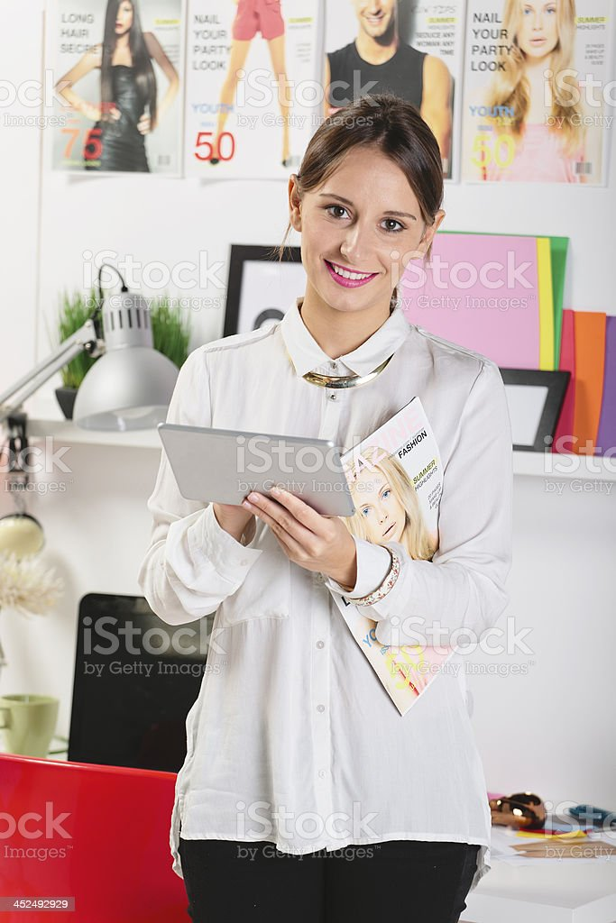 Fashion woman blogger working in a creative workspace with digit stock photo
