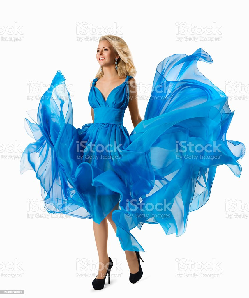 Fashion Woman Blue Dress Flying Fabric, Elegant Girl Waving Gown stock photo