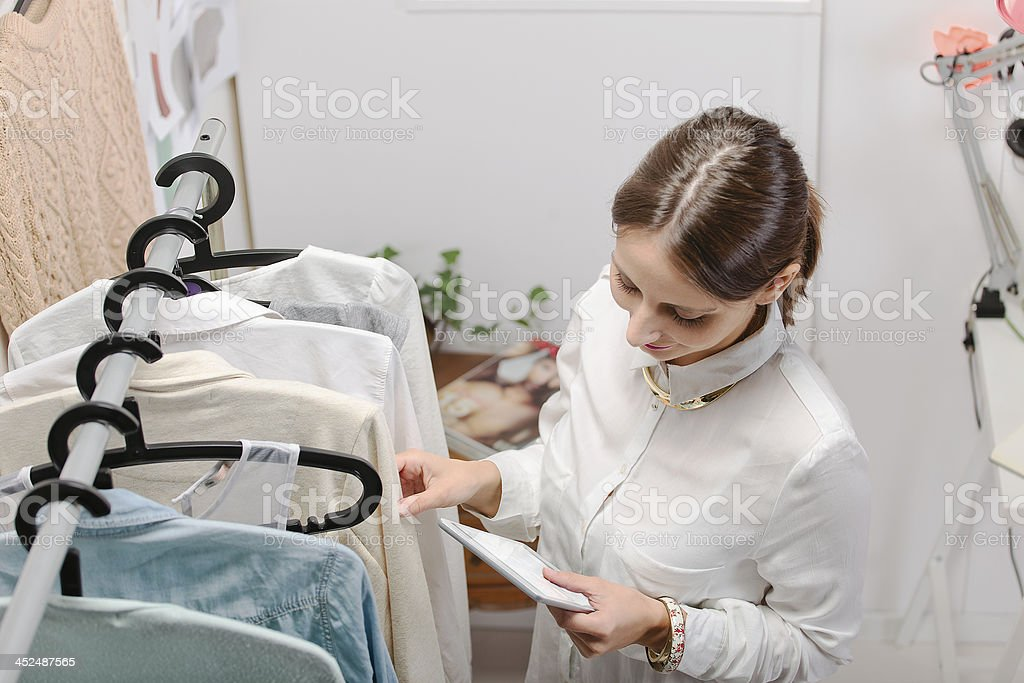 Fashion woman choosing a piece for the new collection. stock photo