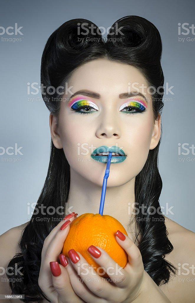 fashion woman drinking orange juice royalty-free stock photo