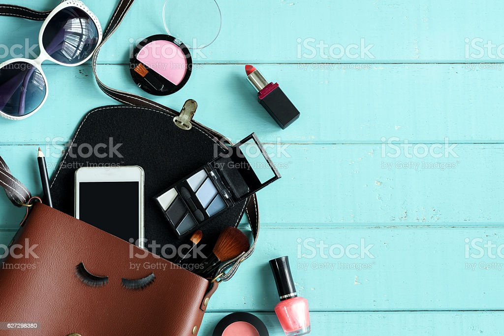 Fashion woman essentials and accessories on wooden background stock photo