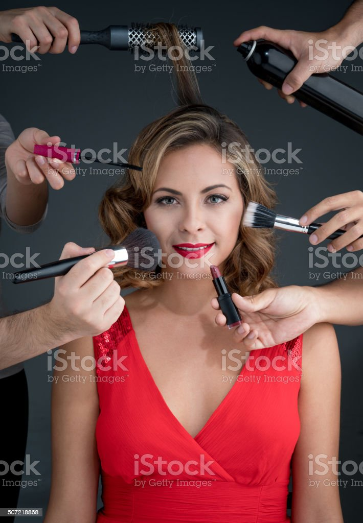 Fashion woman getting her makeup done stock photo