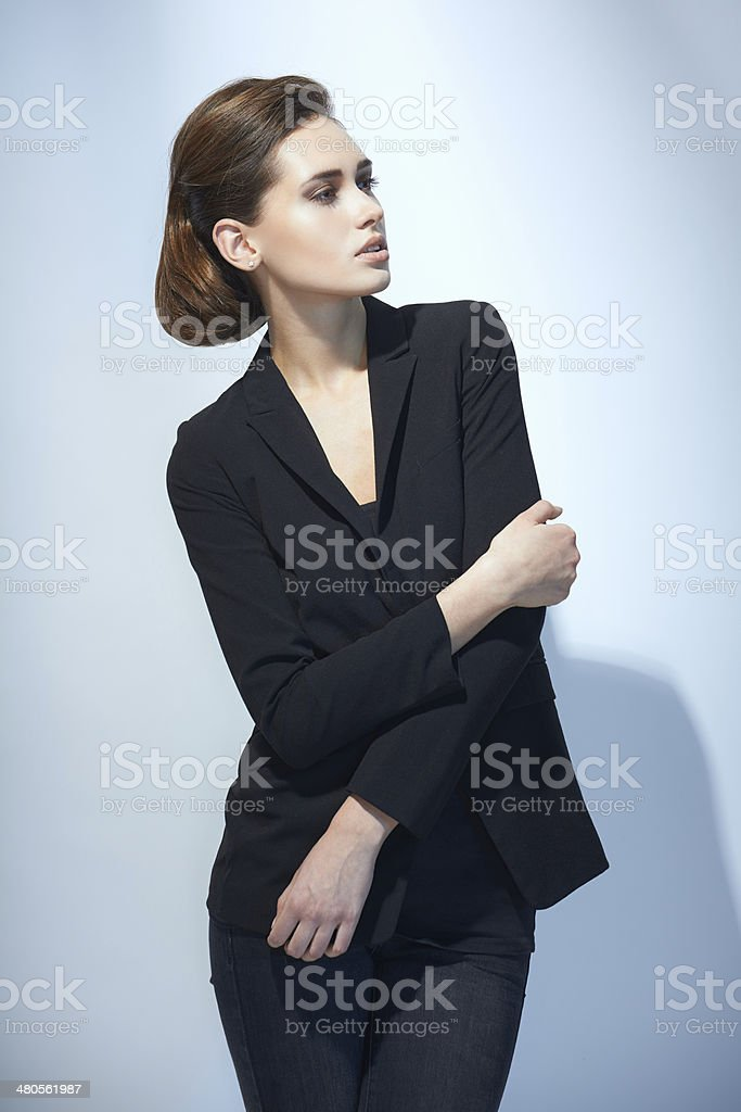 Fashion woman in black suit stock photo