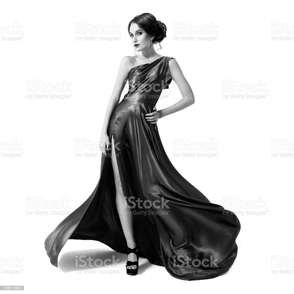 Fashion woman in fluttering dress. Black and white image. stock photo