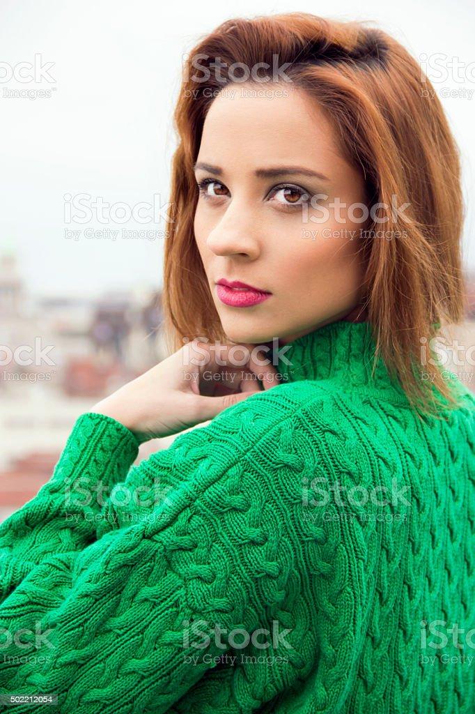 fashion woman in green sweater stock photo
