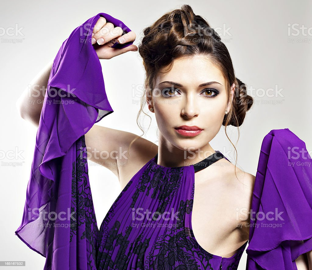 fashion woman in violet dress with  stylish  hairstyle royalty-free stock photo
