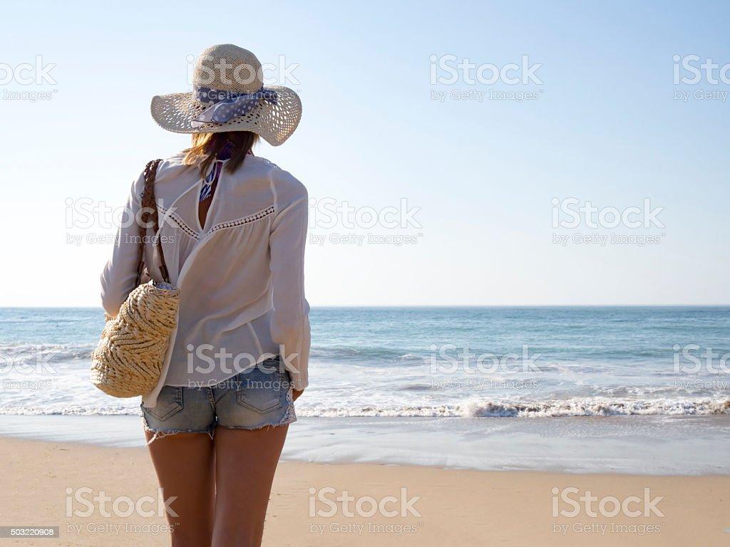 Fashion woman on beach stock photo