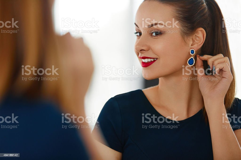 Fashion Woman Portrait. Beautiful Elegant Female Smiling Jewelry stock photo